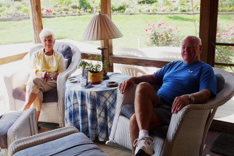 Sue and Don Byerly, sitting on their back porch